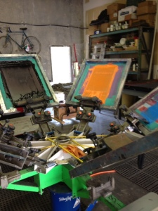 Manual screen printing press.